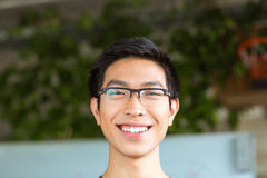 Asian positive cheerful young man in glasses Stock Photo