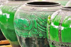 Asian pottery. Beautiful asian pot from Thailand. In the old days, this pottery is used as rain water container for washing feet before entering a house Stock Images