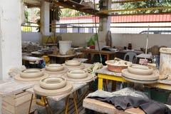 Asian pottery production floor royalty free stock photos