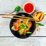 Asian prawns with rice noodles and spring rools Stock Images
