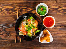 Asian prawns with rice noodles and spring rools Royalty Free Stock Photos