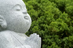 Asian praying sculpture Royalty Free Stock Photo