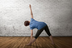 Asian pregnant mother doing gymnastics in empty room Royalty Free Stock Photography