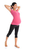 Asian pregnant woman doing yoga stretching Stock Photo
