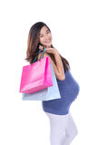Asian Pregnant woman holding paper bag Royalty Free Stock Photo