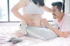 Asian pregnant woman with husband. Will be Mom and having kid. Asian pregnant women with husband. Mother day and International women day. Will be Mom and having stock images