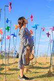Asian pregnant woman in the middle of colorful pinwheel royalty free stock photos
