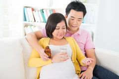 Asian pregnant woman having medicine at home Stock Photography