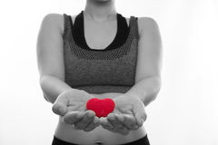 Asian Pregnant women in sport bras  hold red heart shape sign on Stock Images