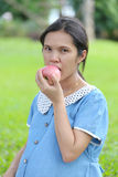 Asian pregnant women using hand catch apple up eating. Stock Image