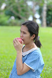 Asian pregnant women using hand catch apple up eating. Stock Photos