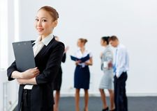 Asian pretty business woman with folder Stock Photography