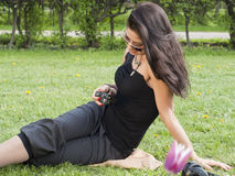 Asian pretty girl with camera. On the spring grass Stock Image