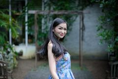 Asian pretty girl has relaxing with happy and smiling at Little. Tree Garden cafe, Nakhon Pathom province, Thailand in the morning. background beautiful beauty royalty free stock images