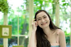Asian pretty girl has relaxing with happy and smiling at Little. Tree Garden cafe, Nakhon Pathom province, Thailand in the morning. background beautiful beauty stock photos
