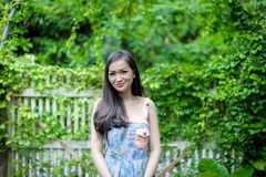 Asian pretty girl has relaxing with happy and smiling at Little Tree Garden cafe, Nakhon Pathom province, Thailand in the morning. Background beautiful beauty stock image