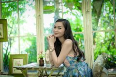 Asian pretty girl has relaxing with happy and smiling at Little Tree Garden cafe, Nakhon Pathom province, Thailand in the morning. Background beautiful beauty stock photos