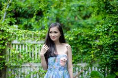 Asian pretty girl has relaxing with happy and smiling at Little Tree Garden cafe, Nakhon Pathom province, Thailand in the morning. Background beautiful beauty royalty free stock images