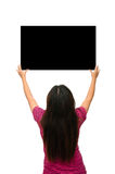 Asian Pretty Girl stand back and Holding black board in two hand Stock Image