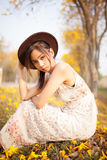 Asian pretty girl surrounded by the yellow flowers in summer Royalty Free Stock Images