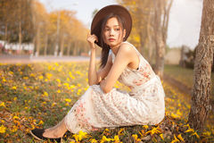 Asian pretty girl surrounded by the yellow flowers in summer Stock Photo