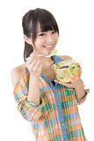 Asian pretty woman eats salad Stock Image