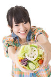 Asian pretty woman gives a salad to you Royalty Free Stock Photography