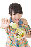 Asian pretty woman gives a salad to you Stock Images