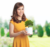 Asian pretty woman with a pot Stock Photos