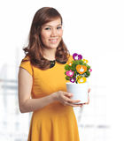 Asian pretty woman with pot of Facebook like plant Stock Photo