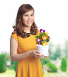 Asian pretty woman with pot of Facebook like plant Royalty Free Stock Image