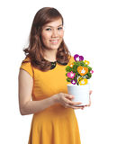 Asian pretty woman with pot of Facebook like plant Royalty Free Stock Photography