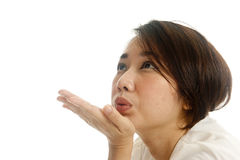 Asian pretty woman sending kisses. On white background Royalty Free Stock Photography