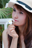 Asian prettywoman with frangipani Royalty Free Stock Image