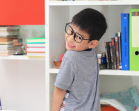 Asian primary school student looking at camera smiling while stu Stock Photos