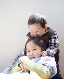 Asian princess girl with her younger brother. In a party Royalty Free Stock Photo