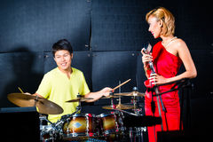 Asian professional band recording song in studio Royalty Free Stock Photos