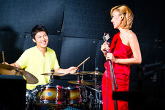 Asian professional band recording song in studio Royalty Free Stock Photography