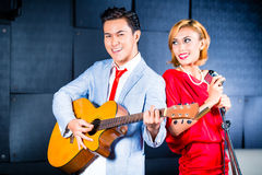 Asian professional band recording song in studio Royalty Free Stock Photo