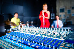 Asian professional band in recording studio mixing. Asian professional recording studio mixing new song of band stock image