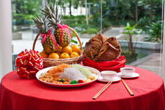 Asian Prosperity Toss, Lohei, Huat Kueh, Pineapple and Oranges. Lou Sang, Yee Sang, Yu Sheng, Yuu Sahng, Lo Hei, Prosperity Toss, Huat Kueh, Pineapple and royalty free stock photos