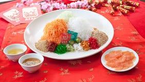 Asian Prosperity Toss, Lohei, Yusheng, yee sang. Prosperity Toss, also known as lo hei, Yusheng, yee sang or yuu sahng 撈起 捞起. Considered a royalty free stock image