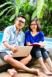 Asian prosperous couple in the garden Stock Images