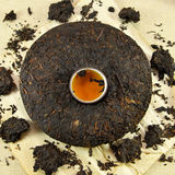 Asian Pu-erh tea with cup in the middle Stock Photography