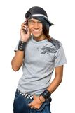 Asian punker calling by cell phone. Asian teenager with cap and cell phone, calling and smiling, and with punk one-sided colored long hair. Emo and friendly royalty free stock image