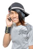 Asian punker calling by cell phone Stock Photo