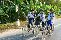Asian pupil ride bicycle Stock Images