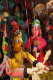 Asian puppets. Colorful asian puppets on a string stock photo