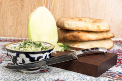 Asian radish and old oriental knife Royalty Free Stock Image