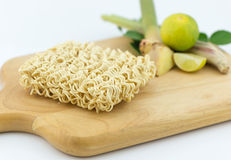 Asian ramen instant noodles on cutting block isolated Stock Images